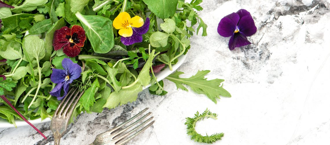 Salad leaves with herbs and flowers. Diet. Healthy food. Detox